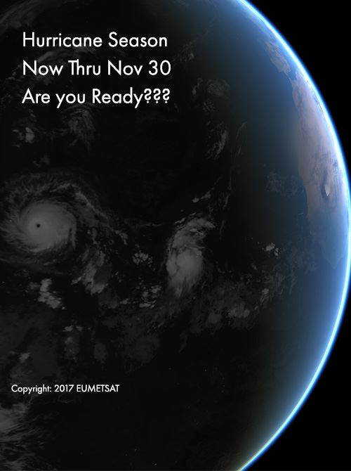 Globe with sunbeam coming from right illuminating two hurricanes in the Atlantic Ocean