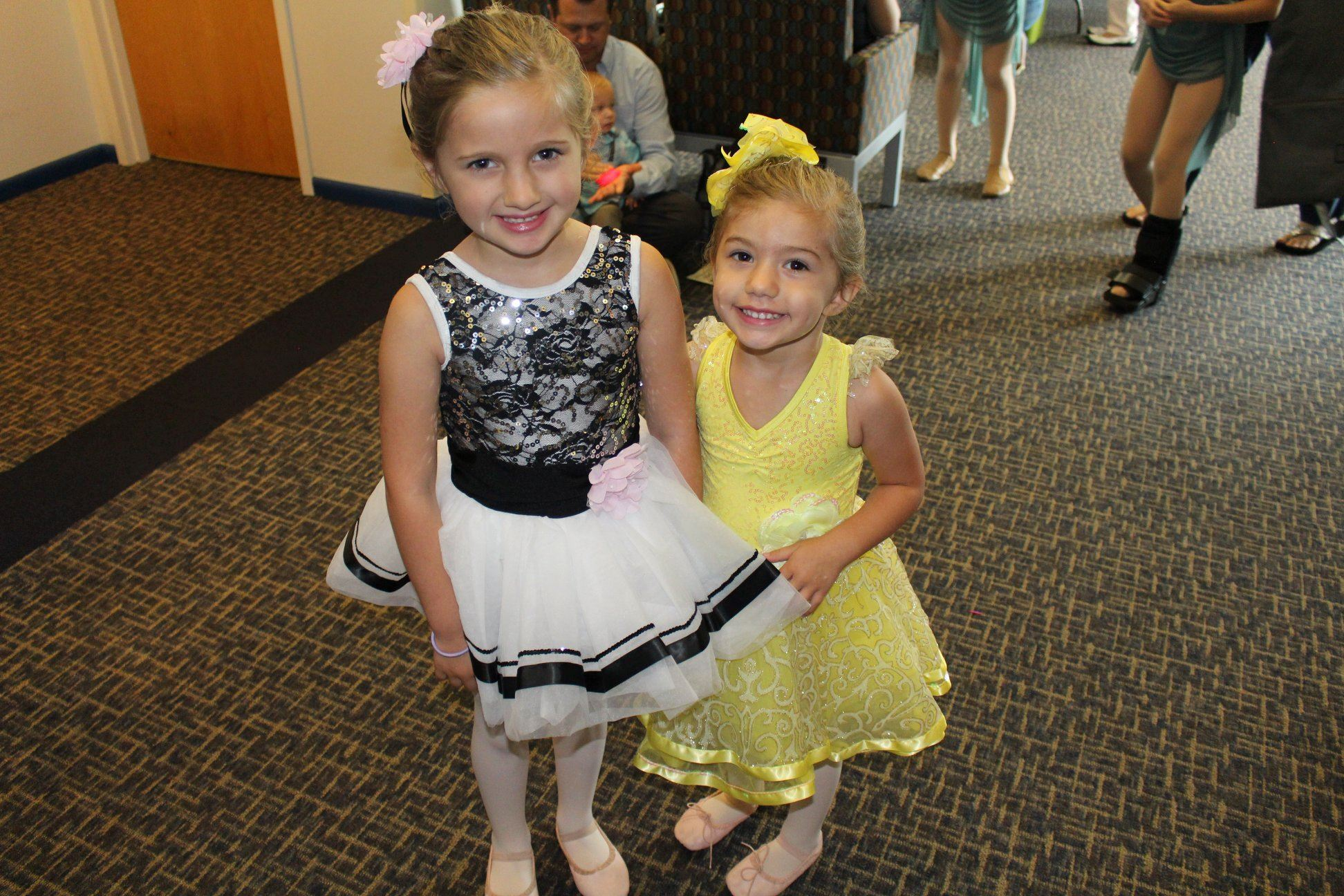 Two girls in ballet costumes