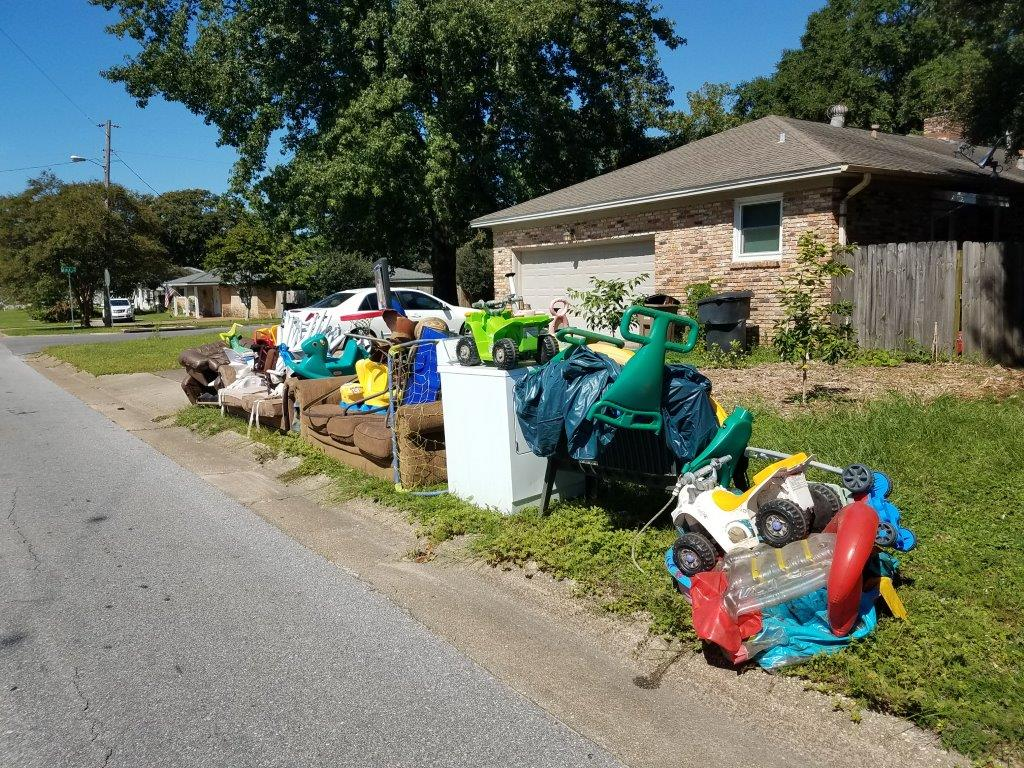Toys and furniture left at the curbside for pickup by City of Pensacola Sanitation