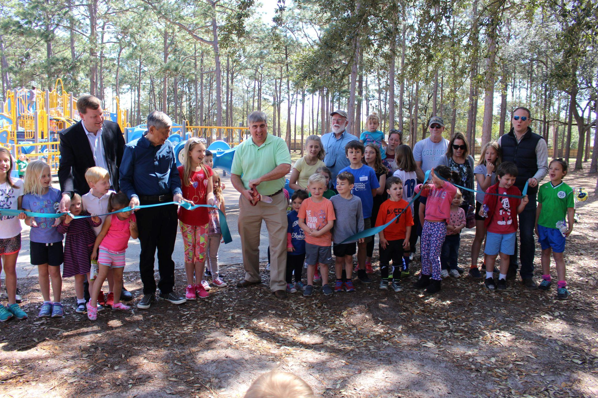 Mayor Grover Robinson and guests cut the ribbon on Hitzman-Optimist Park Playground
